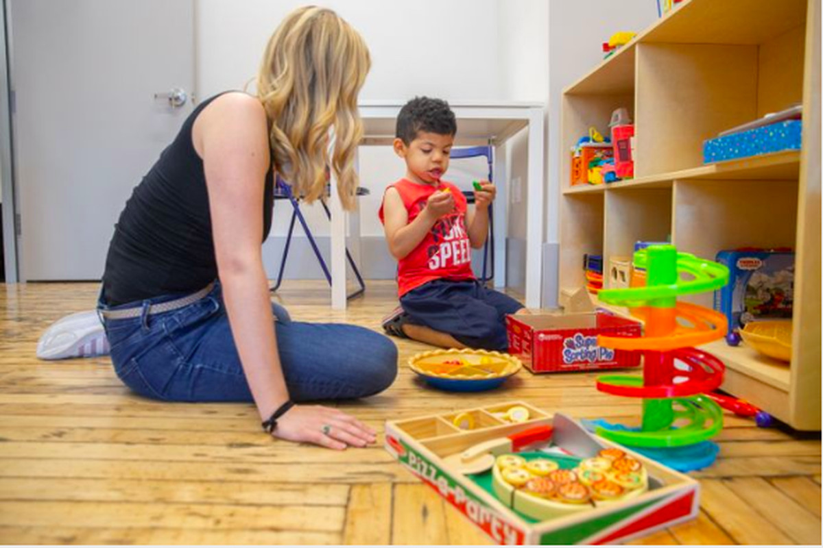 Behavioral therapist Meghan Devine works with 4-year-old Joaquin Rodriguez at the Bridge Kids special education center in Chelsea, June 28, 2019.