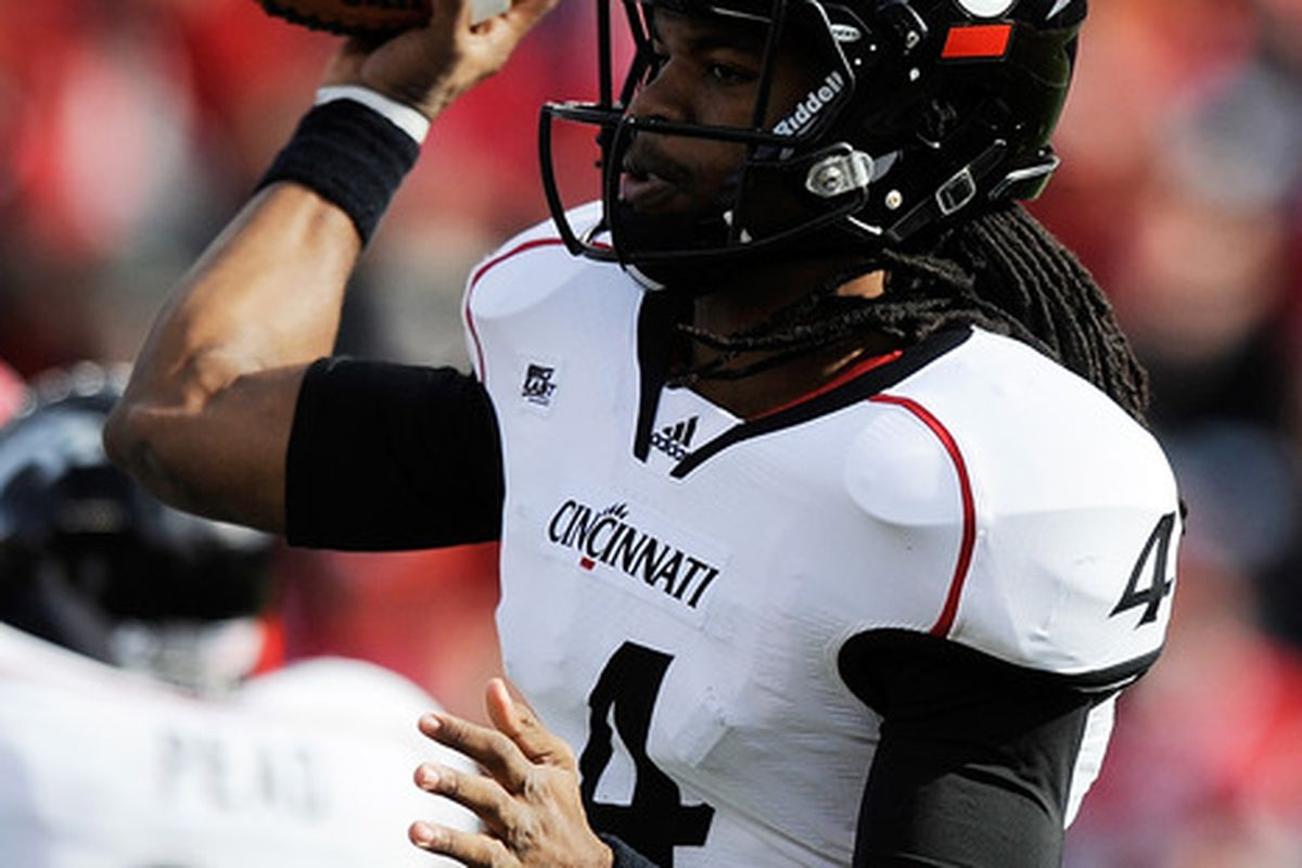 NEW BRUNSWICK, NJ - NOVEMBER 19:  Munchie Legaux #4 of the Cincinnati Bearcats throws a pass against the Rutgers Scarlet Knights at Rutgers Stadium on November 19, 2011 in New Brunswick, New Jersey.  (Photo by Patrick McDermott/Getty Images)
