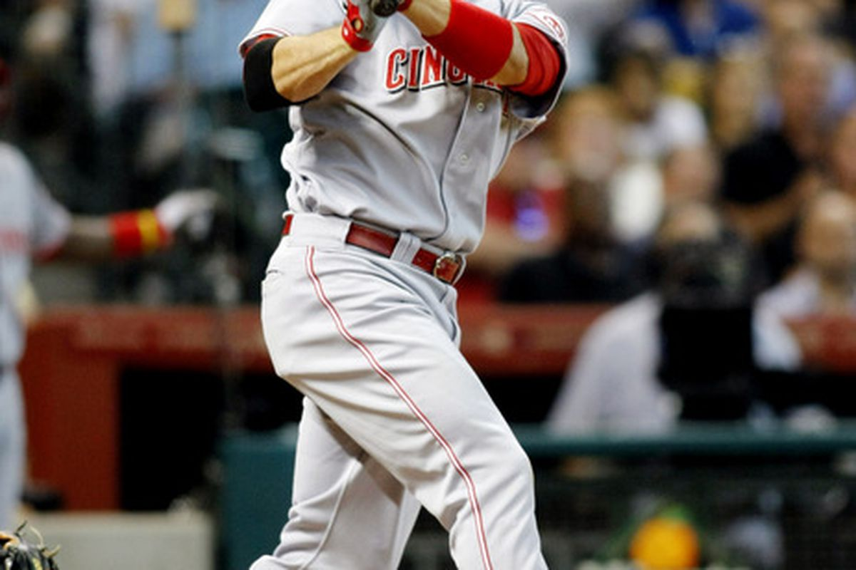 June 2, 2012; Houston, TX, USA; Cincinnati Reds first baseman Joey Votto (19) hits a single against the Houston Astros in the fourth inning at Minute Maid Park. Mandatory Credit: Brett Davis-US PRESSWIRE