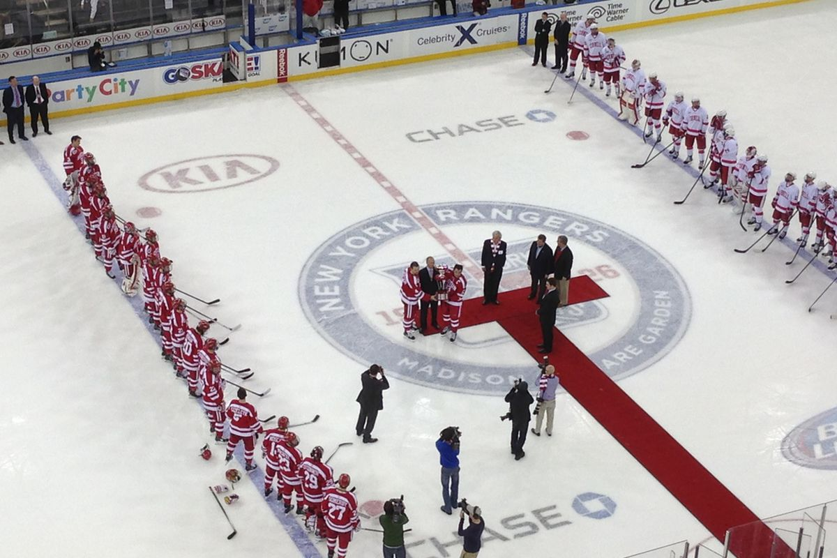 Cornell and BU players stand at the blue line at Madison Square Garden for Red Hot Hockey.