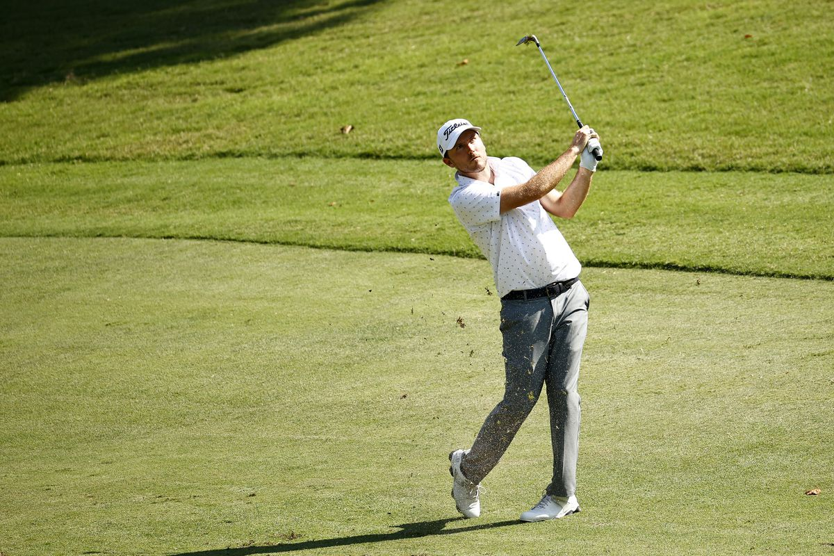Russell Henley of the United States plays an approach shot on the 17th hole during the second round of the Wyndham Championship at Sedgefield Country Club on August 13, 2021 in Greensboro, North Carolina.