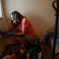 Laura Walton cleans an apartment in Phoenix, Ore., on Monday, Sept. 21, 2020, for a Laura Avalos and her family, who lost their home in the Almeda Fire. Walton and a network of women have banded together to help locate housing and direct other aid to migrant and Latino families impacted by the fire.