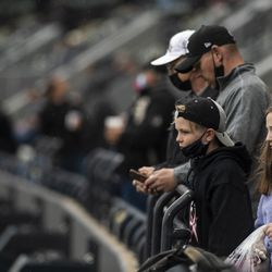 Fans wait for the home opener to begin, against the Kansas City Royals.