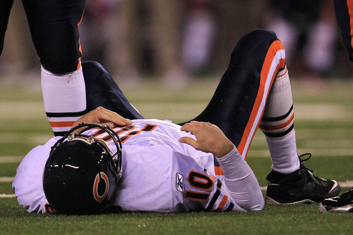 Todd Collins of the Chicago Bears lays on the field after getting injured against the New York Giants at New Meadowlands Stadium Sunday in East Rutherford New Jersey.  (Photo by Chris McGrath/Getty Images)