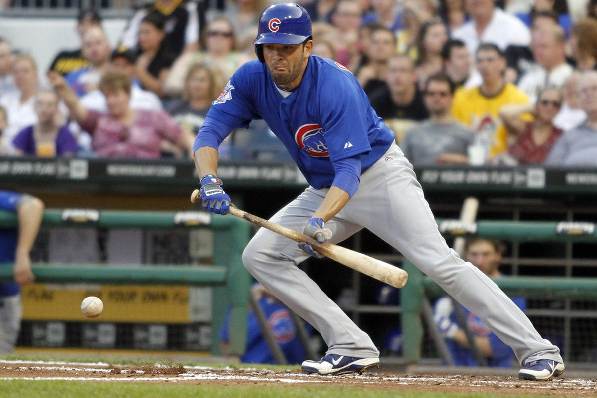 David DeJesus of the Chicago Cubs lays down a bunt to advance the runner against the Pittsburgh Pirates at PNC Park in Pittsburgh, Pennsylvania.  (Photo by Justin K. Aller/Getty Images)