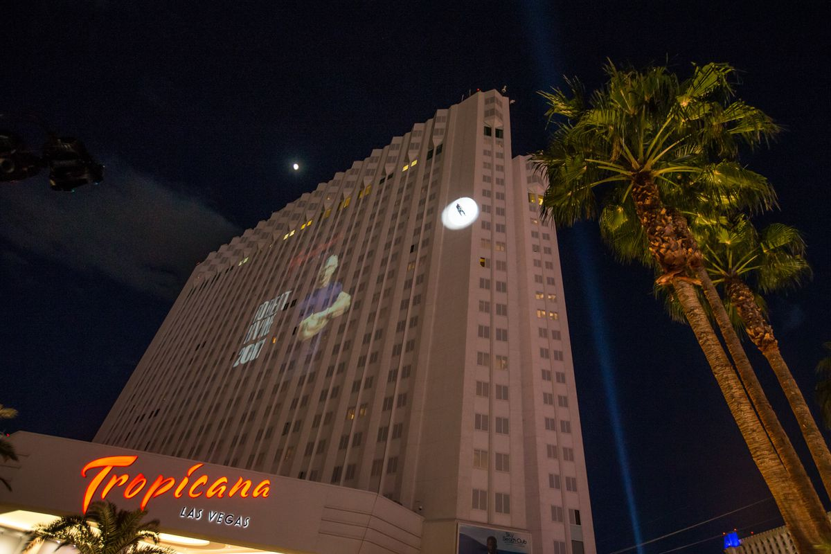 Robert Irvine made his entrance by rappelling 22 stories (220 feet) down the exterior of the Tropicana hotel to announce his new restaurant.