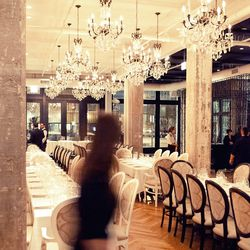 Chandeliers are modeled after those at Villa Nellcôte