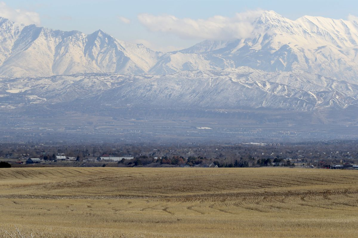 FILE - Land between 6300 West and 8500 West and 12400 South and 13100 South in unincorporated Salt Lake County, foreground, that is proposed for the Olympia Hills development on Monday, March 11, 2019.
