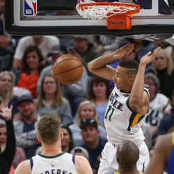 Utah Jazz guard Dante Exum (11) puts the ball in during the game against the Golden State Warriors at Vivint Arena in Salt Lake City on Tuesday, April 10, 2018.