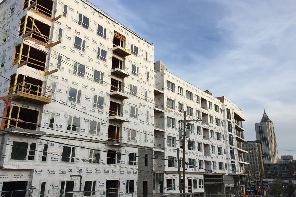A seven-story building, still under construction.