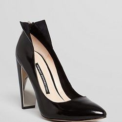 """<a href=""""http://www1.bloomingdales.com/shop/product/french-connection-pointed-toe-pumps-myka-high-heel"""">French Connection pointed toe pumps</a>, $62.40 (were $130)"""