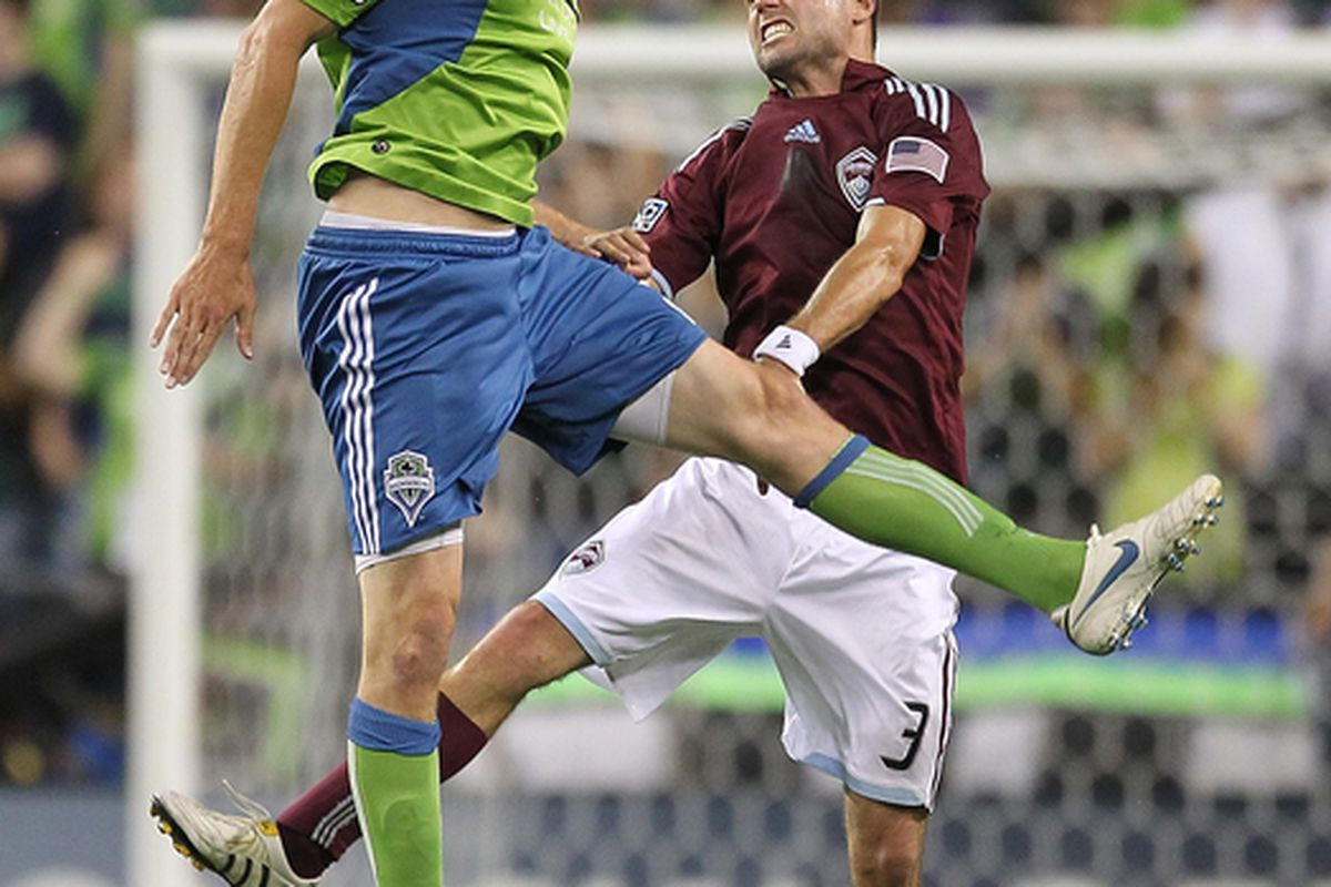 SEATTLE - JULY 25:  Nate Jaqua #21 of the Seattle Sounders FC heads the ball against Drew Moor #3 of the Colorado Rapids on July 25 2010 at Qwest Field in Seattle Washington. (Photo by Otto Greule Jr/Getty Images)