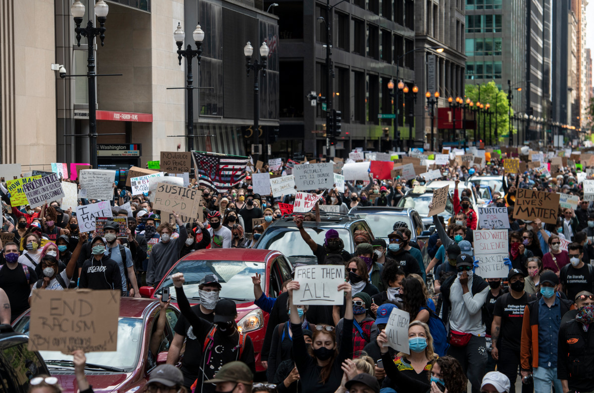 Thousands of demonstrators flooded the streets of downtown Chicago Saturday in a show of anger and sorrow over the killing of George Floyd.