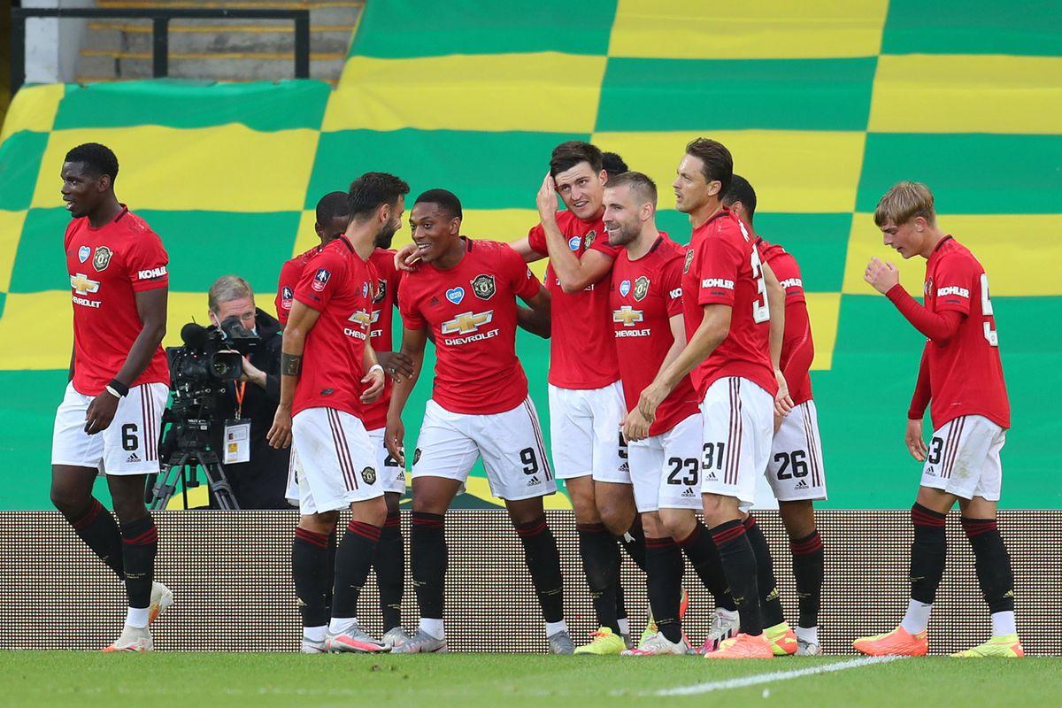 Harry Maguire of Manchester United celebrates with his team mates after scoring his sides second goal during the FA Cup Quarter Final match between Norwich City and Manchester United at Carrow Road on June 27, 2020 in Norwich, England.
