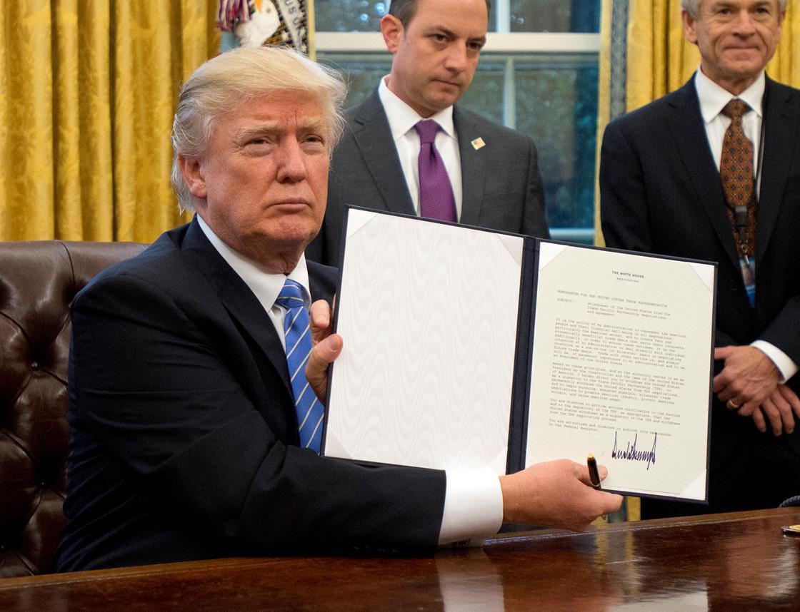 Trump signing an executive order