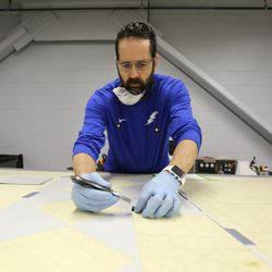 Layen Moffitt cuts carbon fiber material for core composites at Davis Technical College in Kaysville on Wednesday, Jan. 29, 2020.