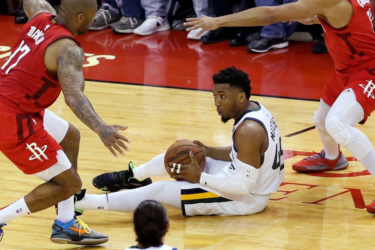 Utah Jazz guard Donovan Mitchell (45) is guarded by Houston during Game 5 of a first-round NBA basketball playoff series in Houston on Wednesday, April 24, 2019.