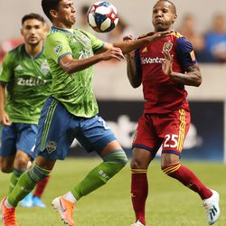 Seattle Sounders defender Xavier Arreaga (25) and Real Salt Lake midfielder Everton Luiz (25) position themselves on the ball as RSL and Seattle play at Rio Tinto Stadium in Sandy, Utah, on Wednesday, Aug. 14, 2019. RSL won 3-0.