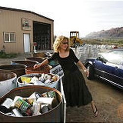 Moab resident Misha Catler sorts her recycling materials at the Canyonlands Community Recycling Center, which opened in 1990.