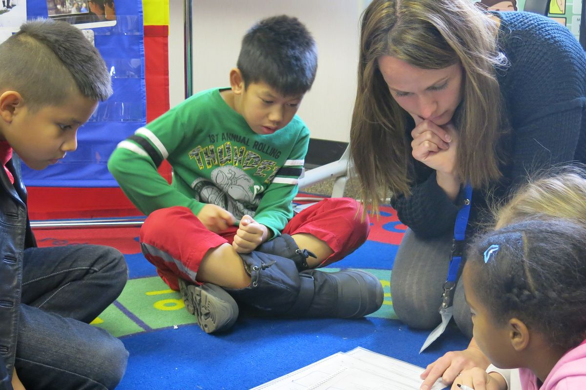 Third graders at Ellis Elementary study English with ESL teacher Bree Roon. Each of these children has a different native language.