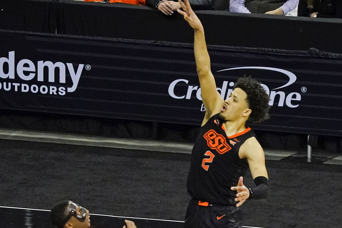 Oklahoma State Cowboys guard Cade Cunningham shoots over Baylor Bears guard Mark Vital during the second half at T-Mobile Center.