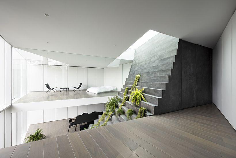 Steep concrete staircase cutting through house