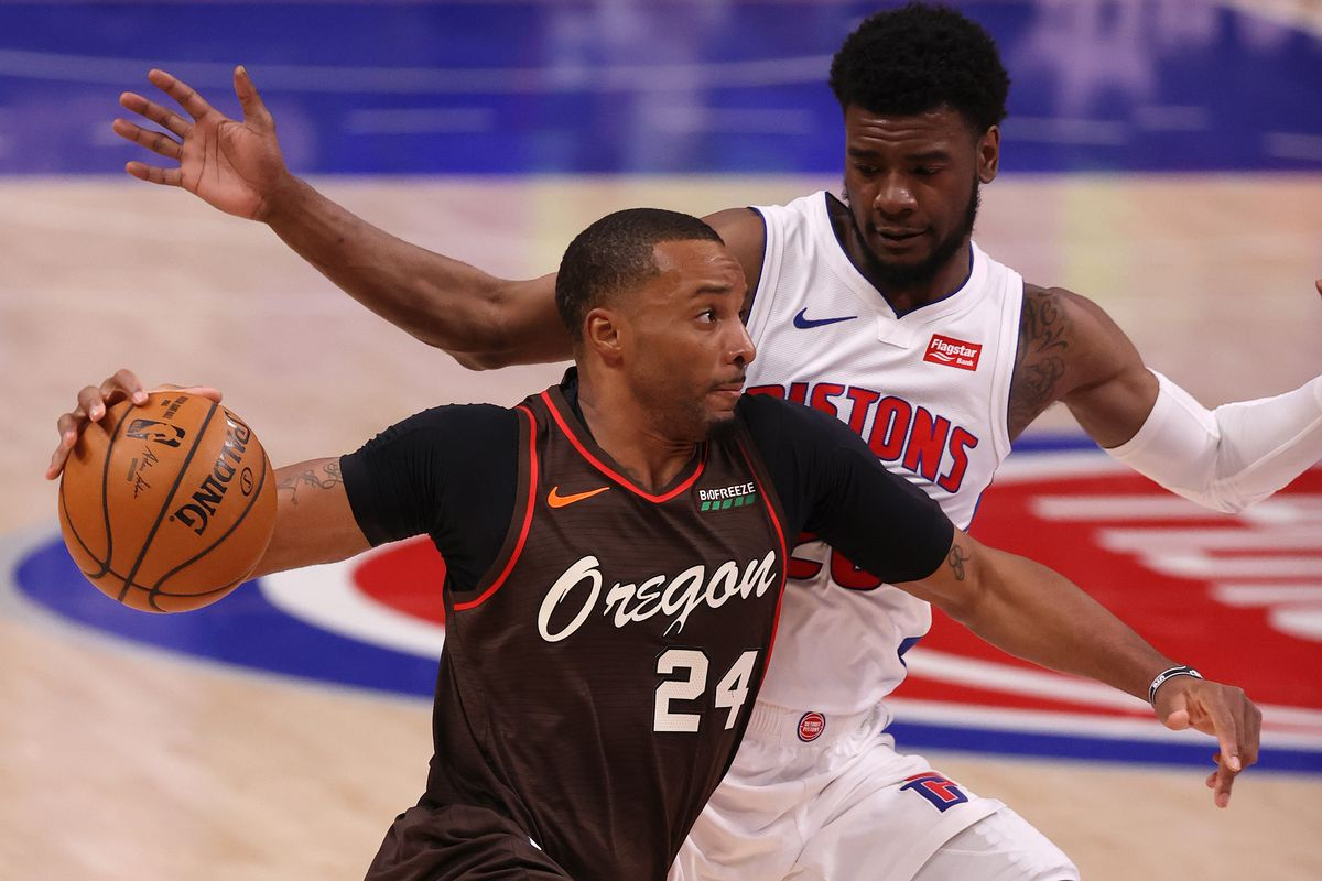 Norman Powell #24 of the Portland Trail Blazers drives around Josh Jackson #20 of the Detroit Pistons during the first half at Little Caesars Arena on March 31, 2021 in Detroit, Michigan.