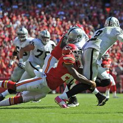 Safety Eric Berry #29 of the Kansas City Chiefs sacks quarterback Terrelle Pryor #2 of the Oakland Raiders during the second half on October 13, 2013 at Arrowhead Stadium in Kansas City, Missouri. Kansas City won 24-7.