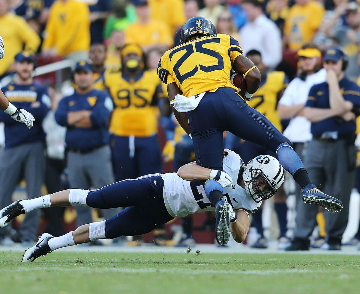 BYU defensive back Austin McChesney works to bring down West Virginia Mountaineers running back Justin Crawford at FedEx Field in Landover, Maryland on Saturday, Sept. 24, 2016.