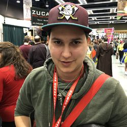 Hockey fan from Vancouver walking around ECCC with a Anaheim Ducks hat.