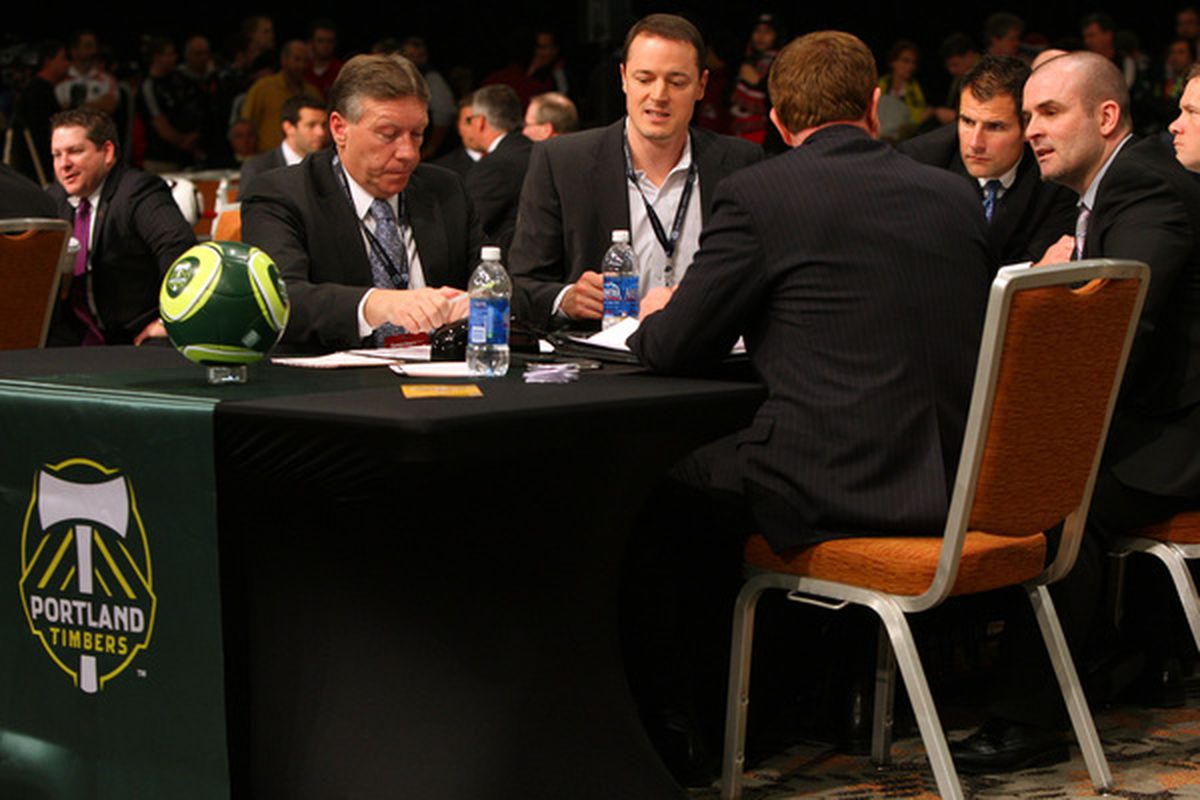 BALTIMORE - JANUARY 13: Coaches and front office staff of the Portland Timbers discuss options during the 2011 MLS SuperDraft on January 13 2011 at the Baltimore Convention Center in Baltimore Maryland. (Photo by Ned Dishman/Getty Images)