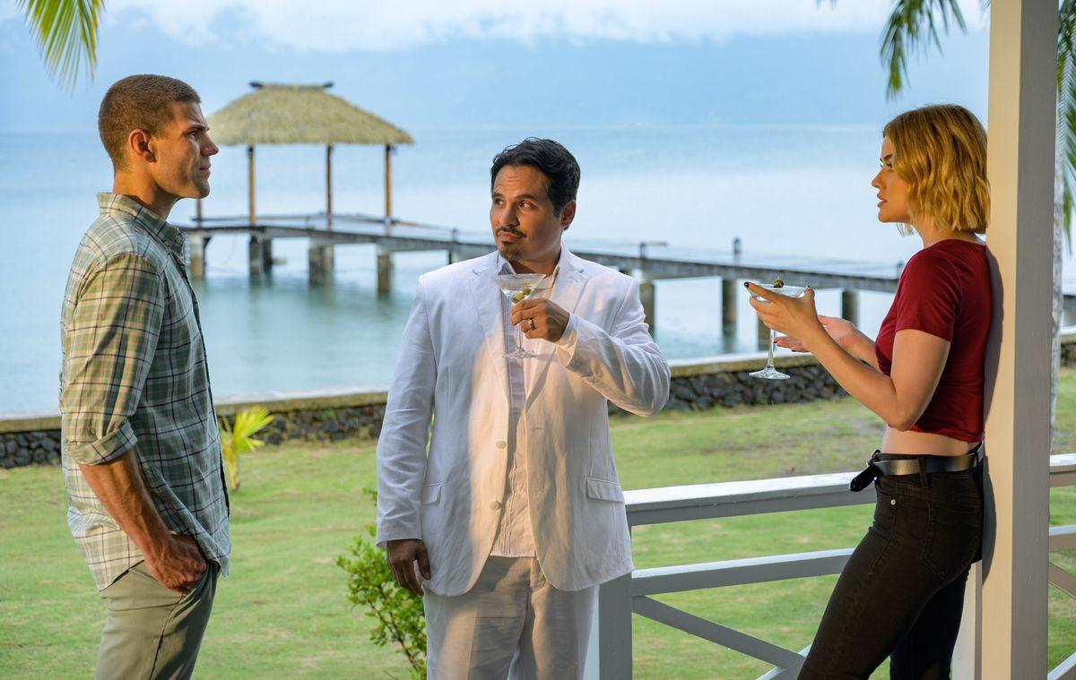 Patrick (Austin Stowell), Mr. Roarke (Michael Peña), and Melanie (Lucy Hale) having drinks at a beachfront bar in Fantasy Island