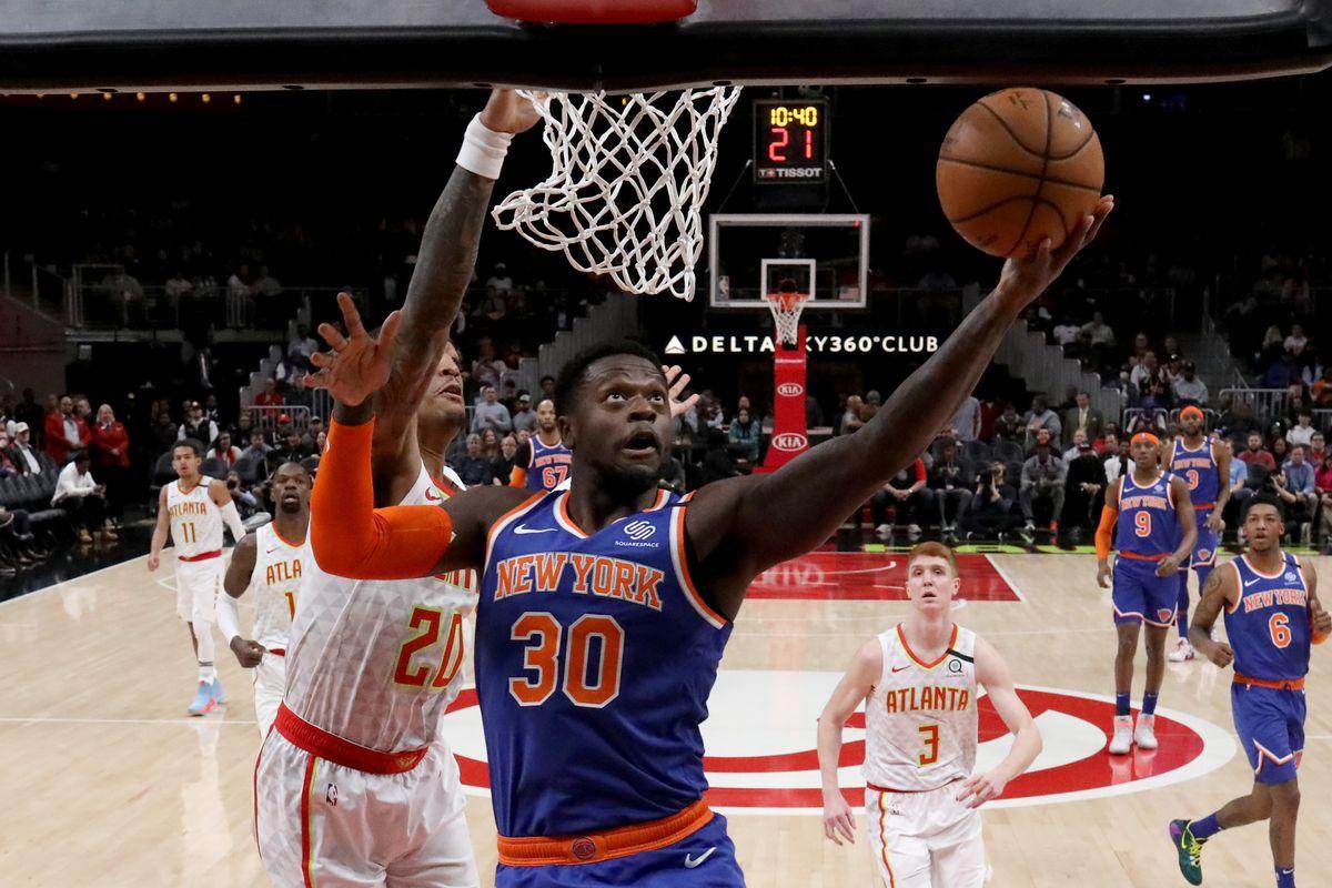 Knicks forward Julius Randle (30) shoots against Atlanta Hawks forward John Collins (20) in the first quarter at State Farm Arena.