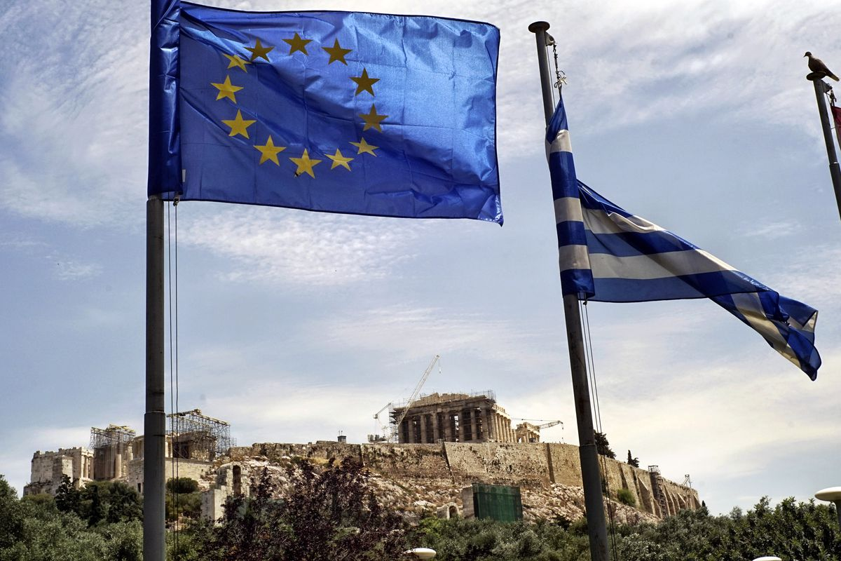 These old ruins symbolize Greece's economy, get it. Also flags.