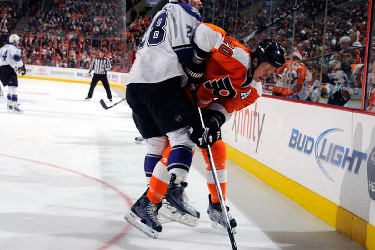 PHILADELPHIA - FEBRUARY 13:  Jarret Stoll #28 of the Los Angeles Kings checking Chris Pronger #20 of the Philadelphia Flyers on February 13 2011 at the Wells Fargo Center in Philadelphia Pennsylvania.  (Photo by Lou Capozzola/Getty Images)