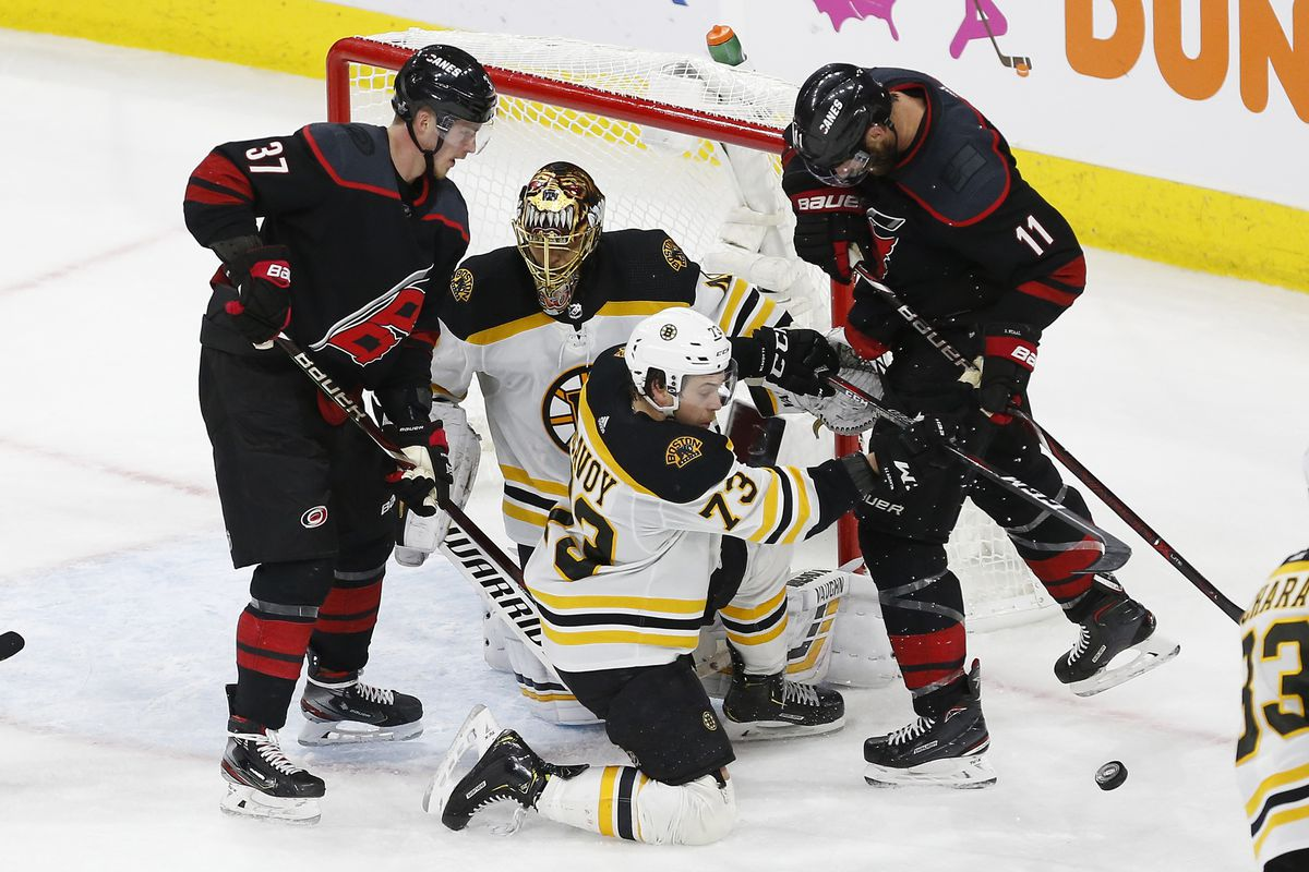 May 14, 2019; Raleigh, NC, USA; Boston Bruins defenseman Charlie McAvoy (73) and Carolina Hurricanes center Jordan Staal (11) battle for the puck in front of Bruins goaltender Tuukka Rask (40) in the third period in game three of the Eastern Conference Fi