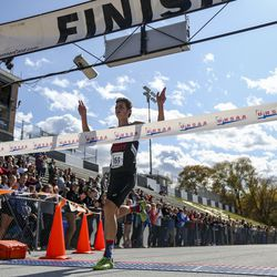Granstville High School runner Porter Whitworth crosses the finish line in first during the 3A Boys State Cross-Country Championships at Highland High School in Salt Lake City on Wednesday, Oct. 23, 2019.