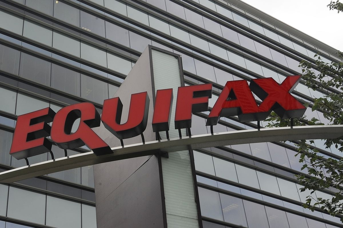 This file photo shows signage at the corporate headquarters of Equifax Inc., in Atlanta. In the two weeks since the Equifax data-breach settlement was announced there have already been at least two websites trying to scam information-seekers.