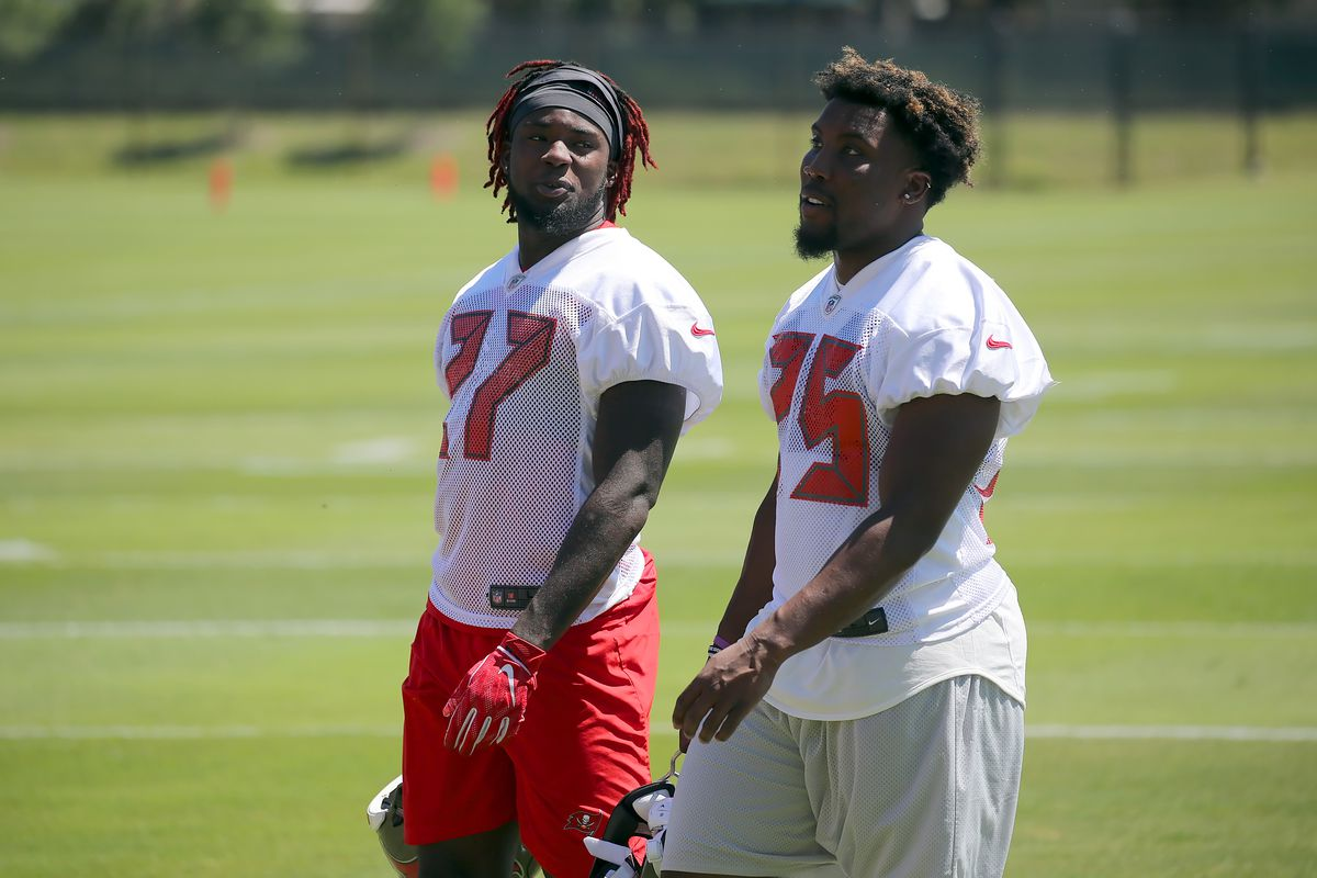 Running backs Ronald Jones and Peyton Barber walk off the field together during the Buccaneers Mini Camp on April 23, 2019 at One Buccaneer Place in Tampa,FL.
