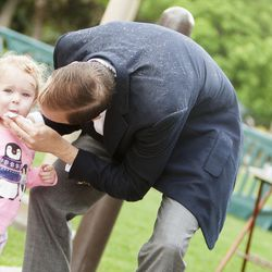 Ruth Carr, 2, gets her a face wiped by her father, Daniel, after having a snack during the groundbreaking ceremony for a new engineering building at BYU in Provo on Monday, May 9, 2016. The new building was entirely funded by donors.