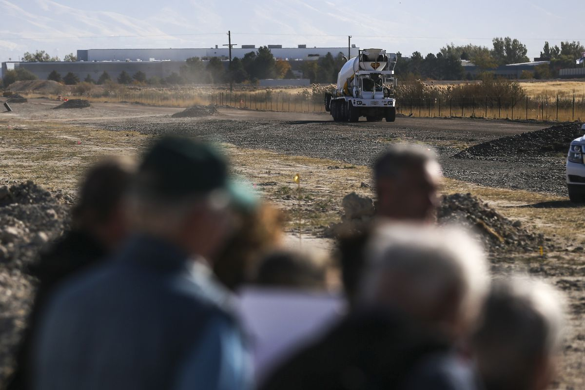 A cement truck kicks up dust as it travels to a construction site during a Stop the Polluting Portpress conference held west of the Salt Lake City International Airport on Wednesday, Oct. 16, 2019. The group called for the halt of development on about 16,000 acres west of the airport, an area under the jurisdiction of the state-created Utah Inland Port Authority but also near sensitive wetland and migratory bird habitat.