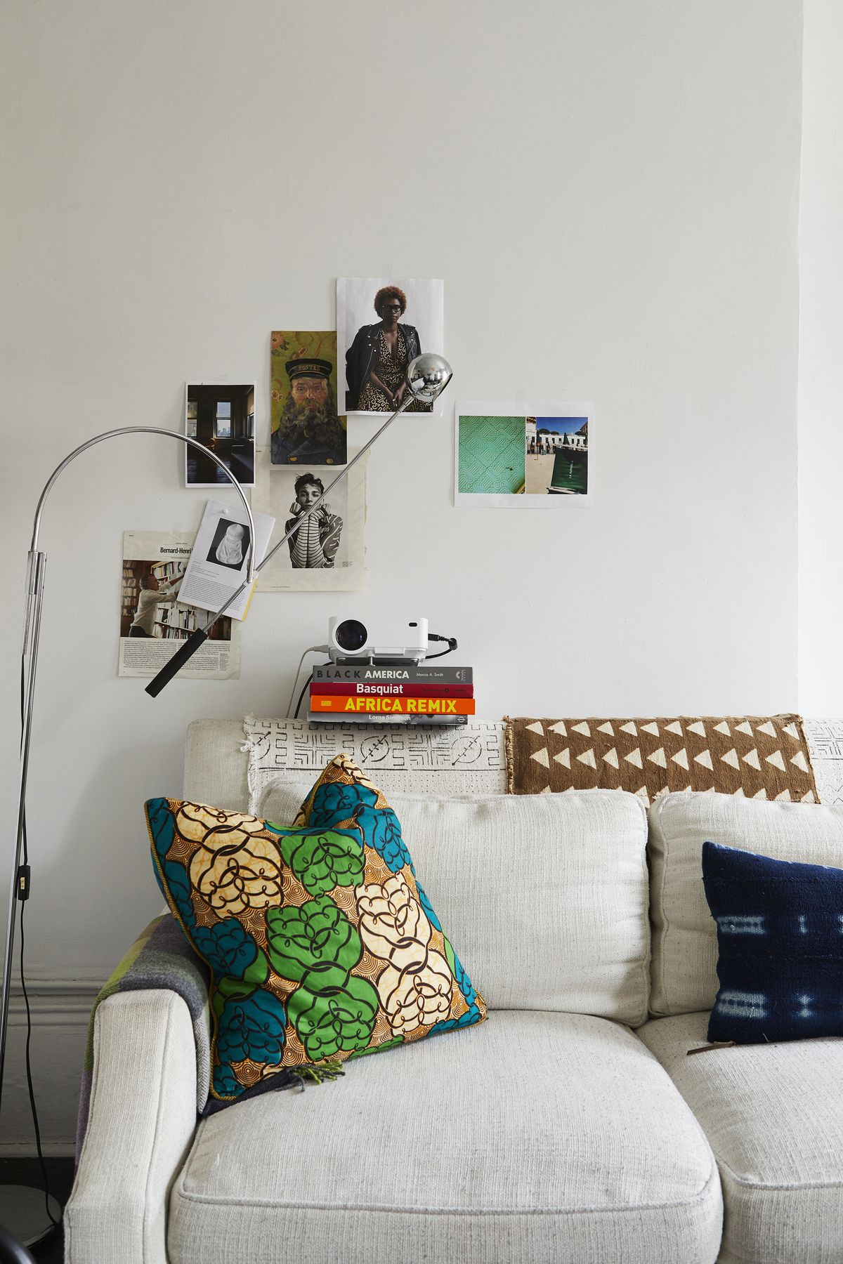 Brightly colored textiles from Africa drape the sofa and are used to make pillows.