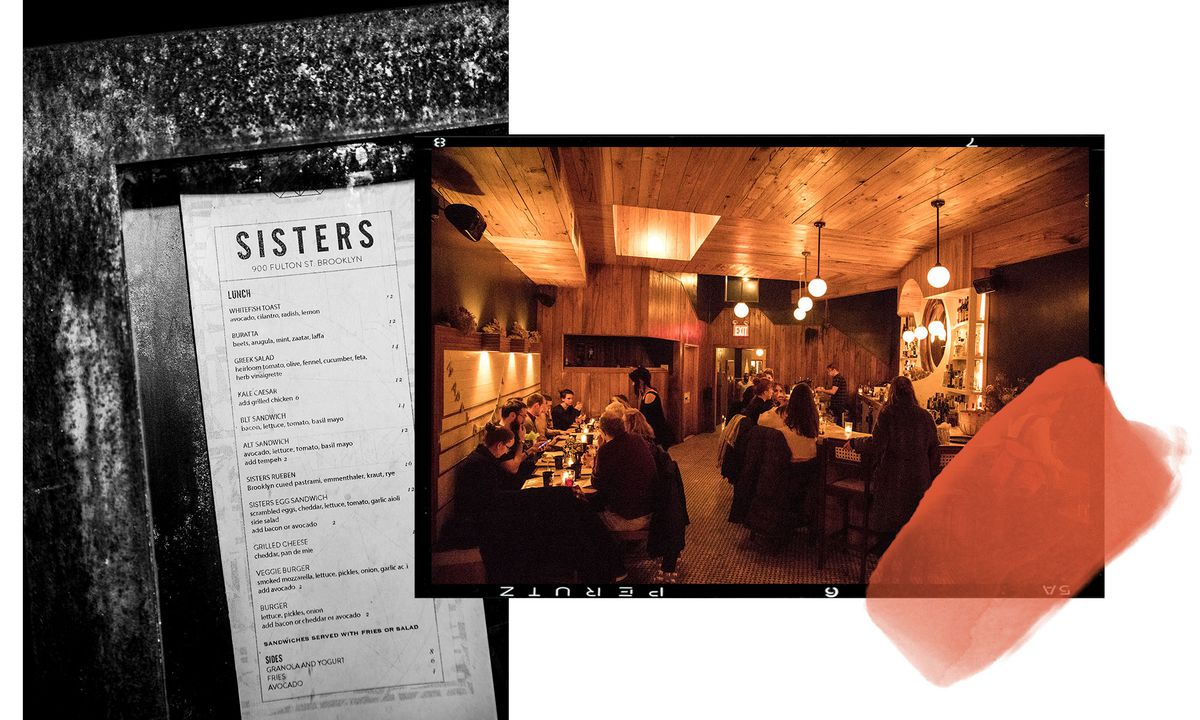 The back bar area of Sisters, along with their lunch menu posted in a window in front.