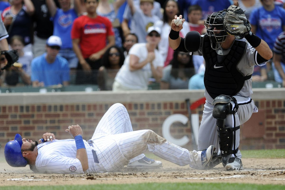 A.J. Pierzynski triumphs over his counterpart on a play at the plate.