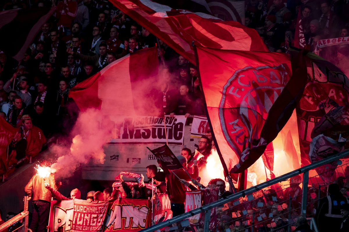 Bayern Munich fans with flags and flares