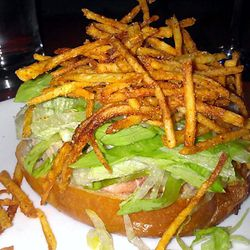 """Lobster roll with sour cream fries from Momofuku Ssam Bar by <a href=""""http://www.flickr.com/photos/37619222@N04/8202476233/in/pool-eater/"""">The Food Doc</a>"""