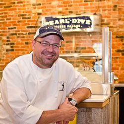 Chef/owner Jeff Black sits at the four-seater oyster bar in Pearl Dive Oyster Palace.