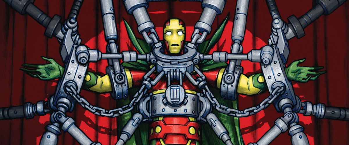 Scott Free, Mister Miracle, is bound in heavy chains in front of a red theater curtain and under a bright spotlight. He has his arms out to his sides, and a lost expression on his face, on the cover of Mister Miracle #1, DC Comics (2017).