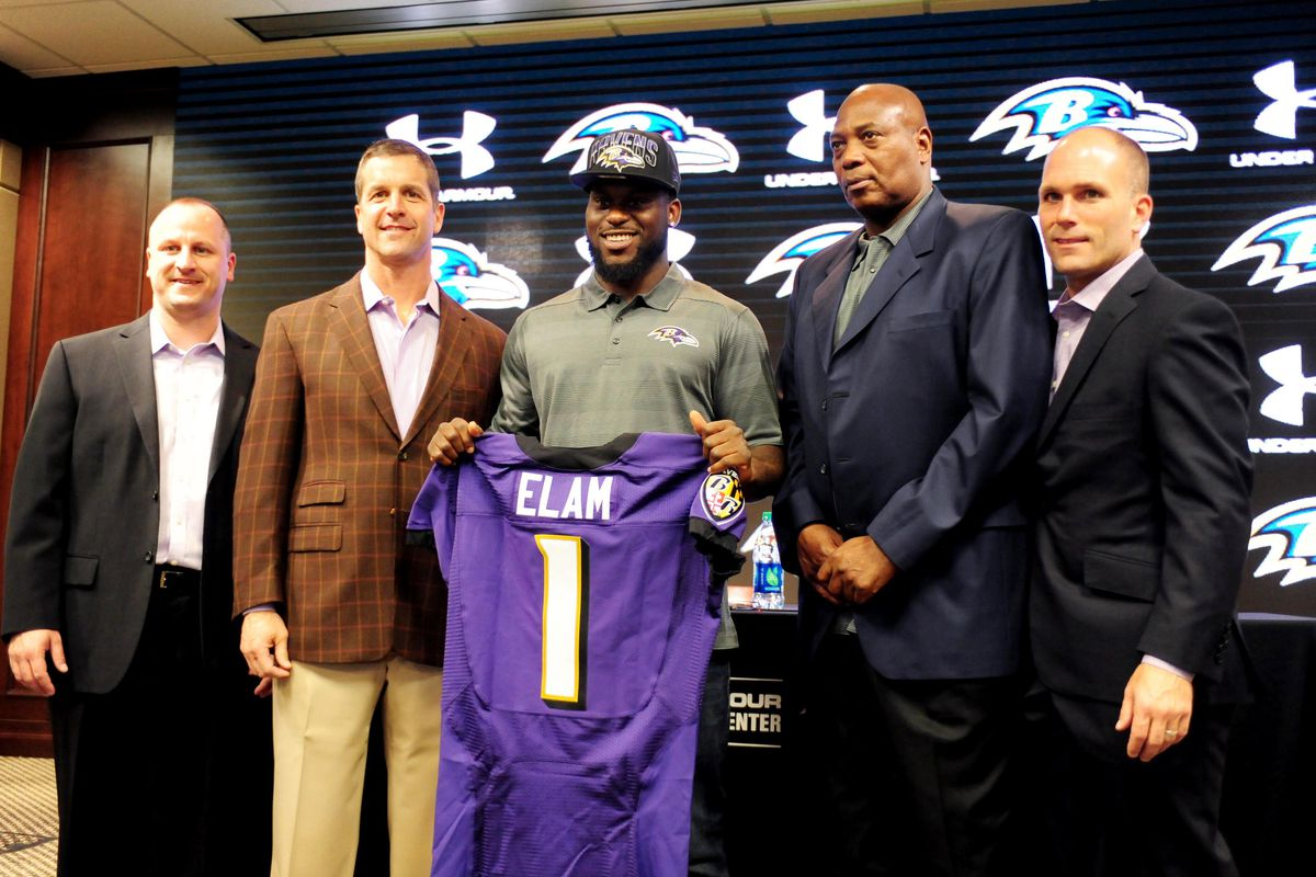 Eric DeCosta (far right) poses with Joe Hortiz, John Harbaugh, Matt Elam and Ozzie Newsome after taking Elam with their first round pick in 2013.
