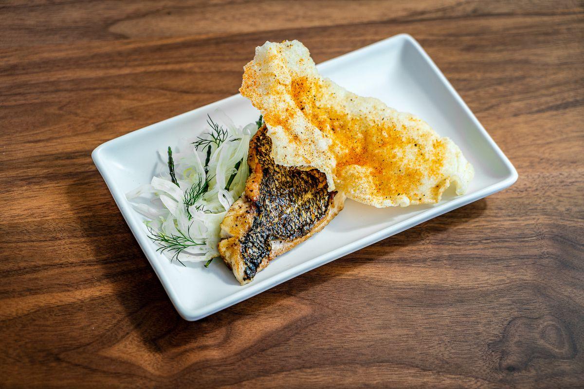 a plate of black sea bass